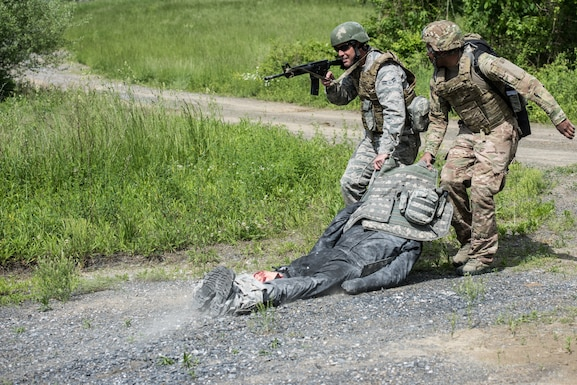 U.S. Airmen from the 193rd Special Operations Medical Group Detachment 1, Pennsylvania Air National Guard, move a casualty to cover during Tactical Combat Casualty Care training.