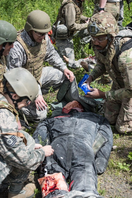 U.S. Airmen from the 193rd Special Operations Medical Group Detachment 1, Pennsylvania Air National Guard, perform medical treatment on a casualty during Tactical Combat Casualty Care training.