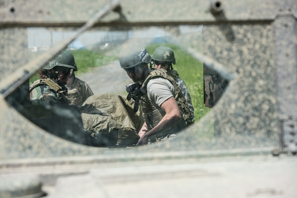 U.S. Airmen from the 193rd Special Operations Medical Group Detachment 1, Pennsylvania Air National Guard, evacuate a casualty into the back of a Humvee during Tactical Combat Casualty Care training.