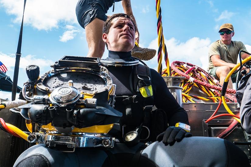 Diver rests on ship.