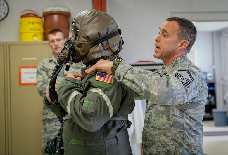 Senior Master Sgt. Jim Haupt, superintendent of aircrew flight equipment assigned to the 910th Operations Support Squadron, checks the fitting of an aircrew eye respiratory protection system of Master Sgt. Rich Lawton, an instructor flight engineer assigned to the 757th Airlift Squadron on May 4, 2019.