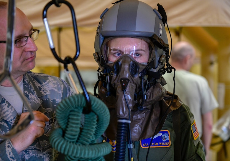 Tech. Sgt. Rob Runnion, an aircrew flight equipment technician assigned to the 910th Operations Support Squadron, gives instructions for the next step in the processing line to Senior Airman Kaleb Walker, a loadmaster assigned to the 757th Airlift Squadron on May 4, 2019.