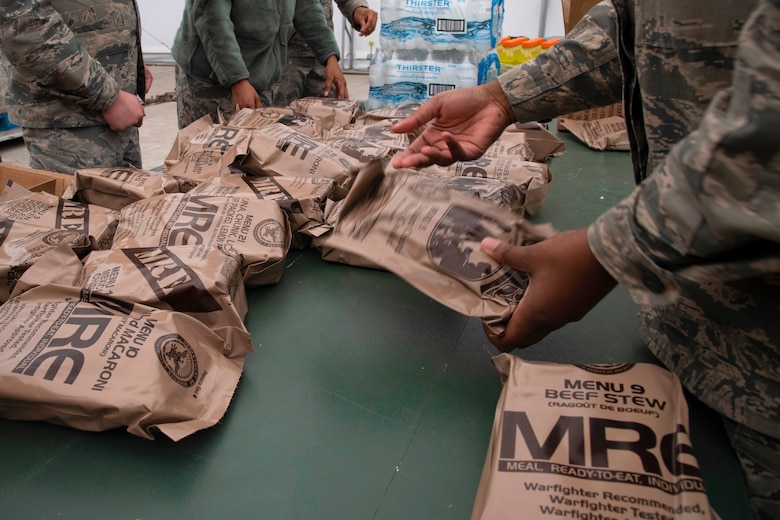 Grand Forks Air Force Base 319th Force Support Squadron airmen sort through ready-to-eat meals May 20, 2019, prior to exercise Summer Viking 19-01 on the Air National Guard Base in Fargo, North Dakota. The readiness exercise focused on preparing and responding to chemical and biological attacks, self-aid and buddy care, and defending a contested base. (U.S. Air Force photo by Senior Airman Elora J. Martinez)
