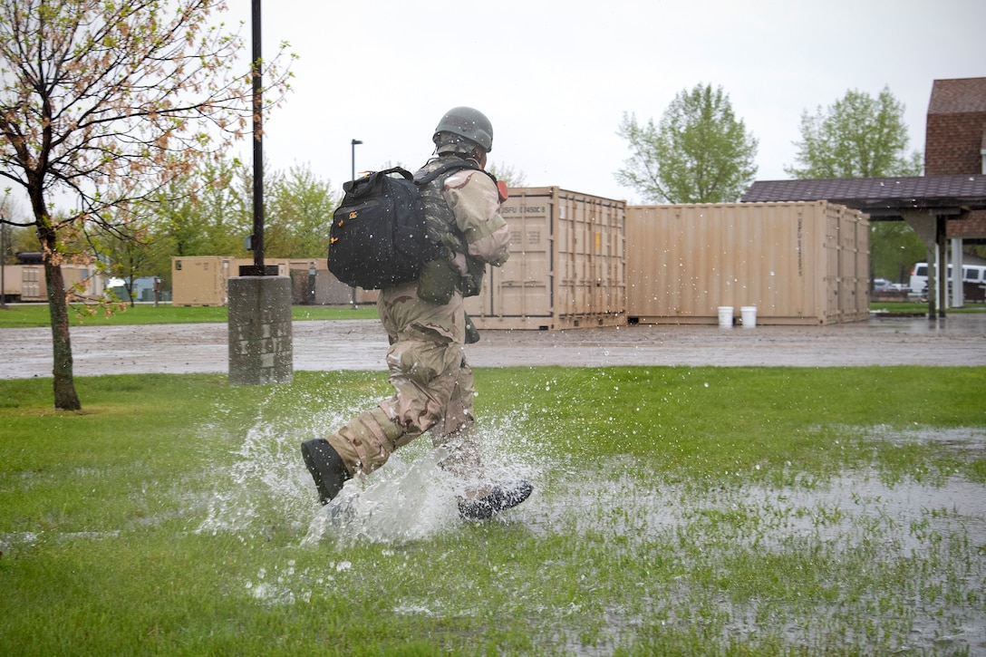 A Grand Forks Air Force Base airman runs across a simulated deployment camp in response to an attack May 22, 2019, during exercise Summer Viking 19-01 on the Air National Guard Base in Fargo, North Dakota. The 4-day exercise tested participants' organizational, expeditionary and readiness skills to better prepare for real deployment. (U.S. Air Force photo by Senior Airman Elora J. Martinez)