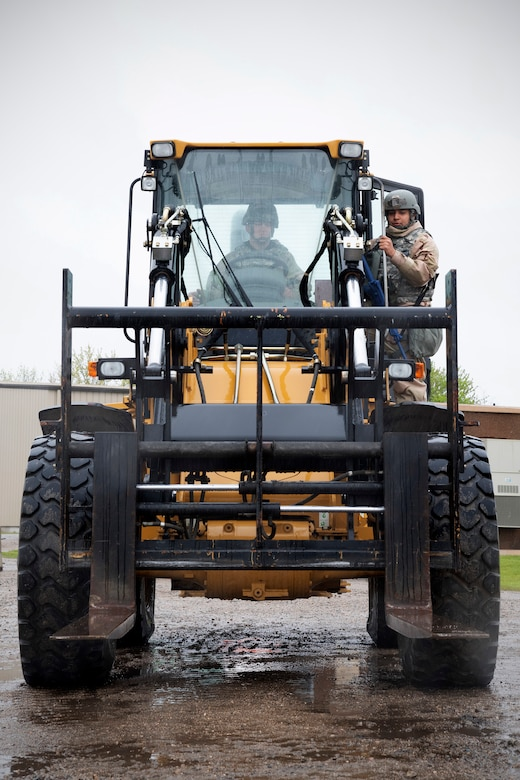Staff Sgt. Hunter Moore, 319th Civil Engineer Squadron water and fuels systems journeyman, left, receives training on how to operate a 10K forklift May 22, 2019, during exercise Summer Viking 19-01 on the Air National Guard Base in Fargo, North Dakota. The 319th CES and 319th Logistics Readiness Squadron were essential in the set-up of the forward operating base used during the exercise, as they transported all equipment and assisted in erecting the temporary camp. (U.S. Air Force photo by Senior Airman Elora J. Martinez)
