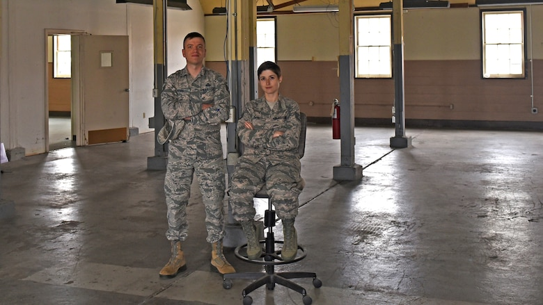 U.S. Air Force Master Sgt. Steel, 517th Training Group command language manager, and Staff Sgt. Brittany Baze, 314th Training Squadron curriculum support, pose within a building being renovated for the future Cryptologic Language Analysists Prep Course at Presidio of Monterey, Calif. May 9, 2019. The class will be open to all languages to help students acquire the tools they need to become the best linguists they can be. (U.S. Air Force photo by Airman 1st Class Zachary Chapman/Released)
