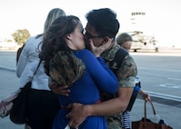 A Marine with Marine Heavy Helicopter Squadron (HMH) 465 embraces his significant other after returning from a six-month deployment to the Indo-Pacific region at Marine Corps Air Station Camp Pendleton, Calif., May 17, 2019. HMH-465's mission was to strengthen international relations, modernize U.S. alliances and protect joint security in the Indo-Pacific region. (U.S. Marine Corps photo by Lance Cpl. Jaime Reyes)
