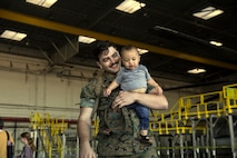 A Marine with Marine Heavy Helicopter Squadron (HMH) 465 holds his son after returning from a six-month deployment to the Indo-Pacific region at Marine Corps Air Station Camp Pendleton, Calif., on May 17, 2019. HMH-465's mission was to strengthen international relations, modernize U.S. alliances and protect joint security in the Indo-Pacific region. (U.S. Marine Corps photo by Lance Cpl. Jaime Reyes)