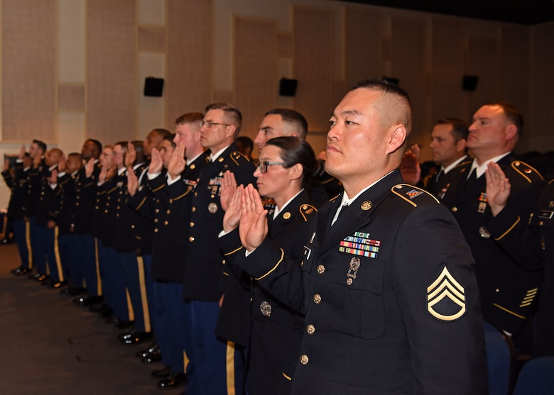 Inductees with the 344th Military Intelligence Battalion recite the Noncommissioned Officer Creed as they prepare to join the NCO Corps, at the NCO Induction Ceremony at the base theater on Goodfellow Air Force Base, Texas, May 21, 2019. The NCO Creed is a time-honored Army tradition that started in 1973. (U.S. Air Force photo by Airman 1st Class Ethan Sherwood/Released)