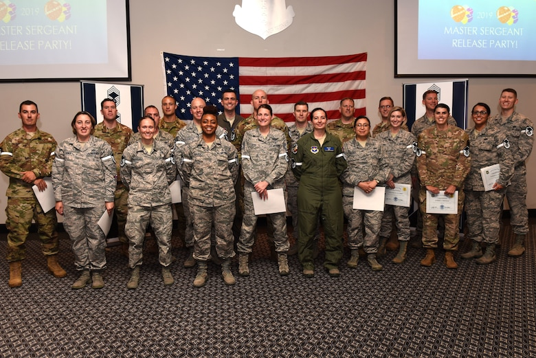 Goodfellow's newest master sergeant selects gather for a group photo during the Master Sergeant Select Ceremony at the event center on Goodfellow Air Force Base, Texas, May 23, 2019. As senior enlisted leaders, master sergeants must reflect the highest qualities of a leader and professional. (U.S. Air Force photo by Senior Airman Seraiah Hines/Released)