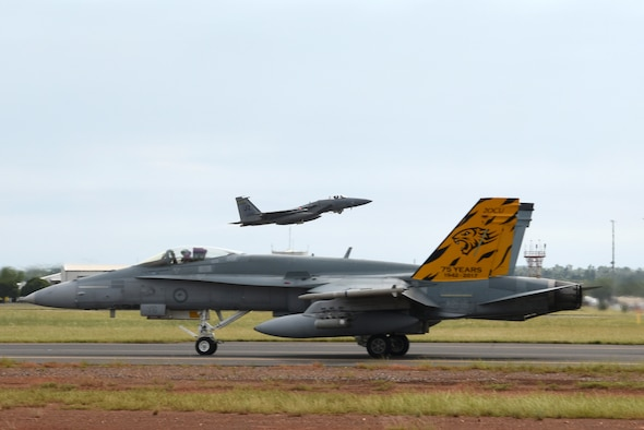 A U.S. Air Force F-15C Eagle assigned to the 194th Expeditionary Fighter Squadron, California Air National Guard, takes off while a Royal Australian Air Force F/A-18A Hornet taxis during Exercise Diamond Storm at RAAF Base Darwin, Northern Territory, May 10, 2019.