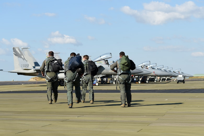 U.S. Air Force pilots assigned to the 194th Expeditionary Fighter Squadron (EFS), California Air National Guard, step to their F-15C Eagles during Exercise Diamond Storm at Royal Australian Air Force Base Darwin, Northern Territory, May 13, 2019.