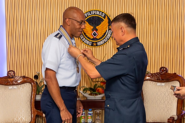 Gen. CQ Brown, Jr., Pacific Air Forces commander, is awarded with honorary Gold Wings from Philippines Air Force Commanding General Lt. Gen. Rozzano Briguez at Villamor Air Base, Philippines, May 16, 2019. The 10-carat command pilot wing symbolizes the highest state of military flying professionalism and dedication. Brown, along with Chief Master Sgt. Anthony Johnson, PACAF command chief, visited the country to demonstrate the United States' shared commitment to peace and security in the region, as well as seek opportunities to enhance interoperability and capability with the PAF.