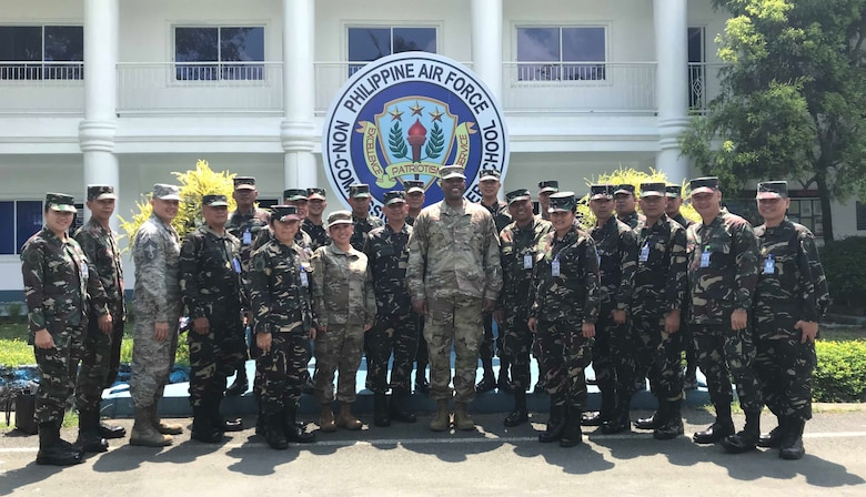 Chief Master Sgt. Anthony Johnson, Pacific Air Forces command chief, poses with members of the Philippine Air Force (PAF) during a visit to Basilio Fernando Air Base, May 17.  During his visit, Johnson met with Air Education, Training and Doctrine Command Sergeant Major Ruperto Rodel Moreto and toured PAF facilities which included Basic Military Training, Non-Commissioned Officer School, Technical and Specialization Training and airmen dormitories.