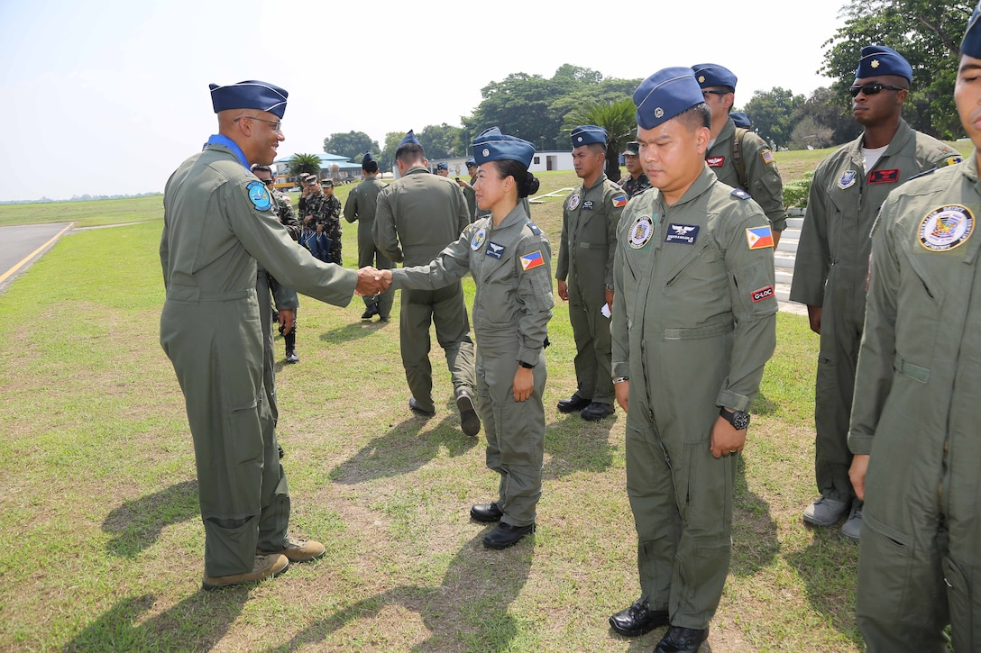 Gen. CQ Brown, Jr., Pacific Air Forces commander, greets Philippines Air Force airmen at Basa Air Base May 17 as part of a three-day visit to the Philippines. Brown, along with Chief Master Sgt. Anthony Johnson, PACAF command chief, visited the country to demonstrate the United States' shared commitment to peace and security in the region, as well as seek opportunities to enhance interoperability and capability with the PAF.