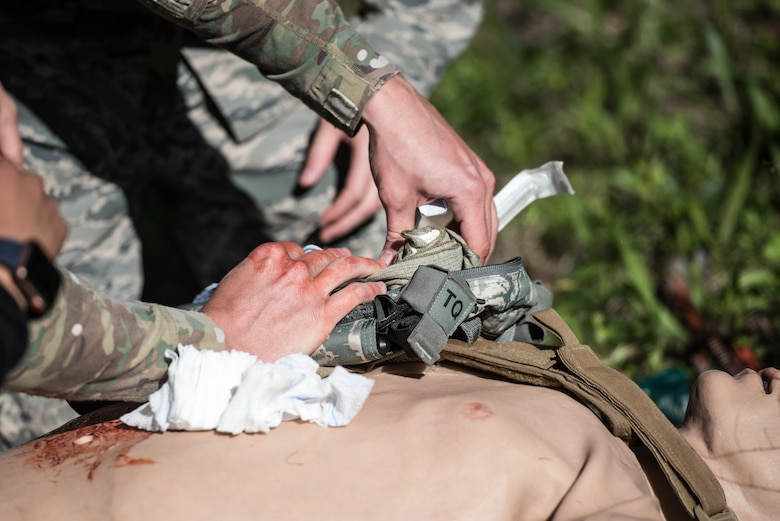 A U.S. Airman from the 193rd Special Operations Medical Group Detachment 1, Pennsylvania Air National Guard, performs medical treatment on a casualty during Tactical Combat Casualty Care training at Annville, Pennsylvania, May 21, 2019. The TCCC training focused on three phases of care: care under fire, tactical field care, and tactical evacuation care. (U.S. Air National Guard photo by Staff Sgt. Tony Harp)