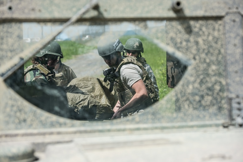 U.S. Airmen from the 193rd Special Operations Medical Group Detachment 1, Pennsylvania Air National Guard, evacuate a casualty into the back of a Humvee during Tactical Combat Casualty Care training at Annville, Pennsylvania, May 21, 2019. The TCCC training provides Airmen with the fundamentals of treating and evacuating casualties in a combat environment. (U.S. Air National Guard photo by Staff Sgt. Tony Harp)