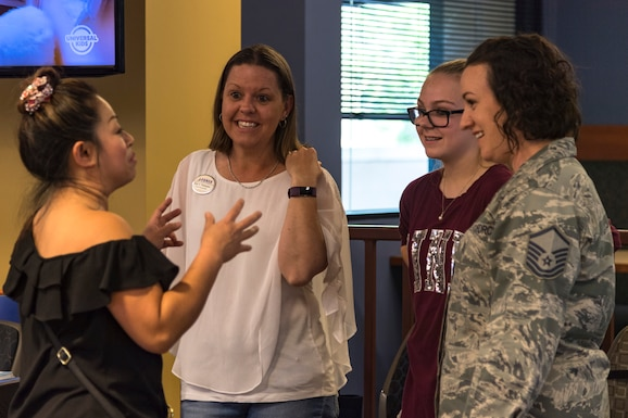 Participants converse during a deployed spouse dinner, May 21, 2019, at Moody Air Force Base, Ga. The dinner served as an opportunity for the families of deployed members to bond and provide relief. The mission's success depends on resilient Airmen and families, who are prepared to make sacrifices with the support of their fellow Airmen, local communities and leadership. (U.S. Air Force photo by Airman 1st Class Taryn Butler)