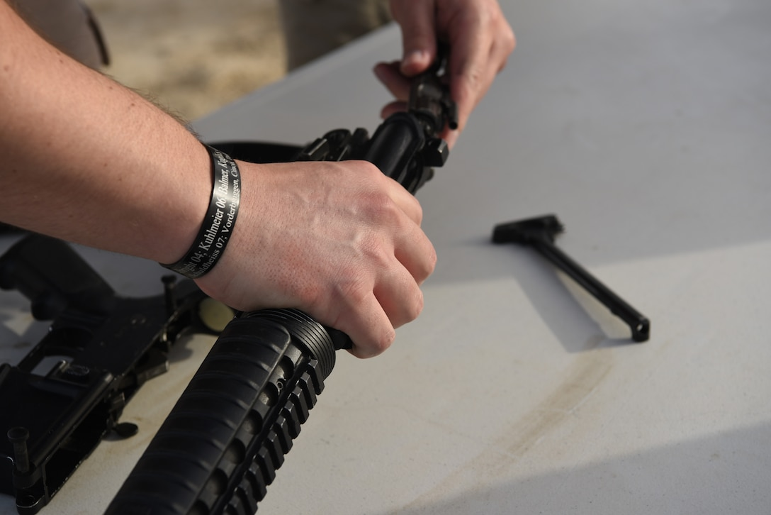 An Airman disassembles a rifle on Al Dhafra Air Base, United Arab Emirates, May 12, 2019.