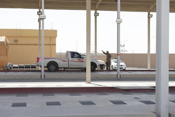 Tech. Sgt. Daniel Becker, 380th Expeditionary Security Forces Squadron defender, brings a car to a halt before inspection May 14, 2019, at Al Dhafra Air Base, United Arab Emirates. Other Country Nationals and their vehicles must be vetted before arriving to the American compounds to ensure the security and safety of the installation. (U.S. Air Force photo by Staff Sgt. Chris Thornbury)