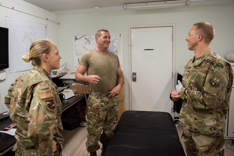The 380th Expeditionary Medical Group physical therapist team talk to a patient after a treatment May 17, 2019 at Al Dhafra Air Base, United Arab Emirates. The team of two performs treatments for pain relief and then educates patients in injury prevention. (U.S. Air Force photo by Staff Sgt. Chris Thornbury)