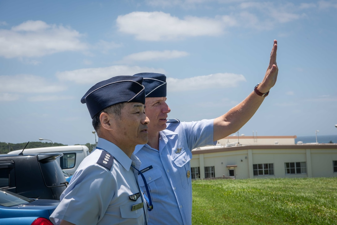 U.S. Air Force Brig. Gen. Case Cunningham, 18th Wing commander explains the origin of Kadena Air Base Habu Hill to Japan Air Self -Defense Force Chief of Staff Gen. Yoshinari Marumo, during a visit to Kadena AB, Japan, May 21, 2019.