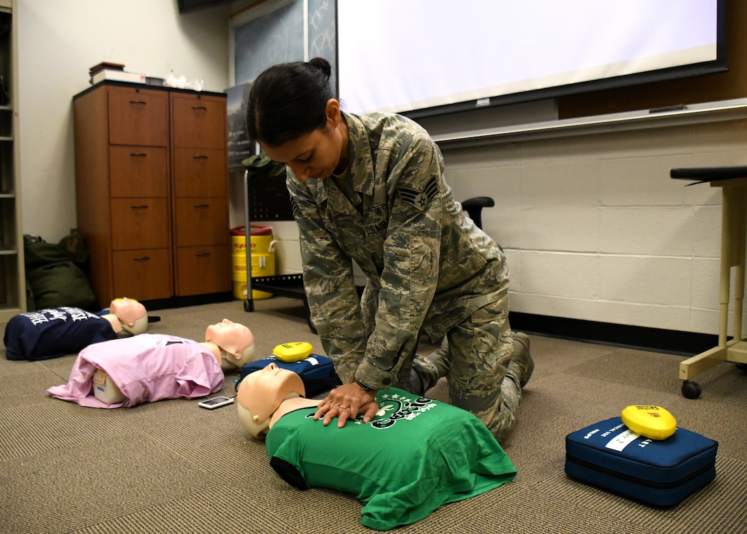 Senior Airman Daniela Rizzari, 104th Medical Group aerospace medical technician, teaches a CPR class at Barnes Air National Guard Base, Massachusetts, May 18, 2019. Rizzari recently graduated from Springfield Technical Community College with a Liberal Arts degree with a science focus. (U.S. Air National Guard photo by Airman 1st Class Randy Burlingame)
