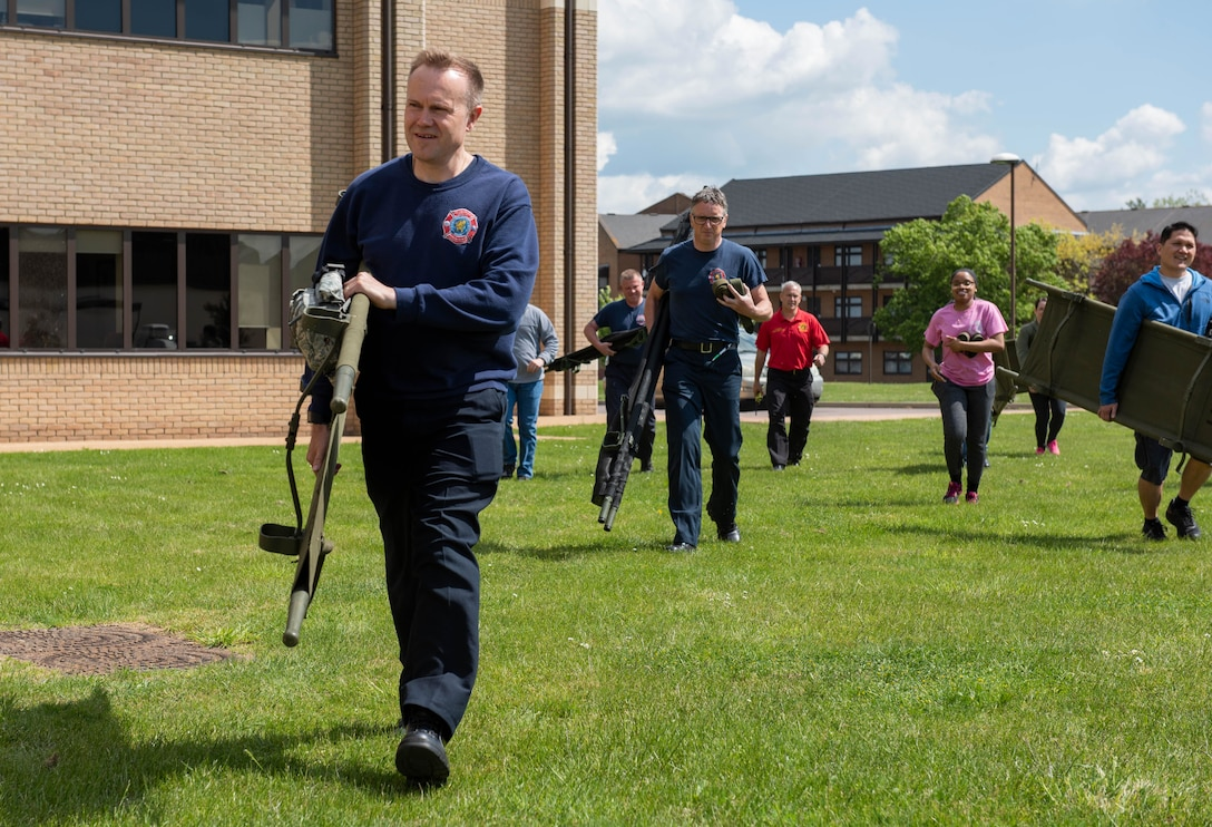 Chris Thorpe, 423rd Civil Engineer Squadron firefighter, carries a gurney to the first-ever joint mass-casualty medical training between the 423rd Medical Squadron and the 423rd CES at RAF Alconbury, England, May 21, 2019. The training between medical specialists and firefighters enhanced their rapid response to mass-casualty situations. (U.S. Air Force photo by Airman 1st Class Jennifer Zima)