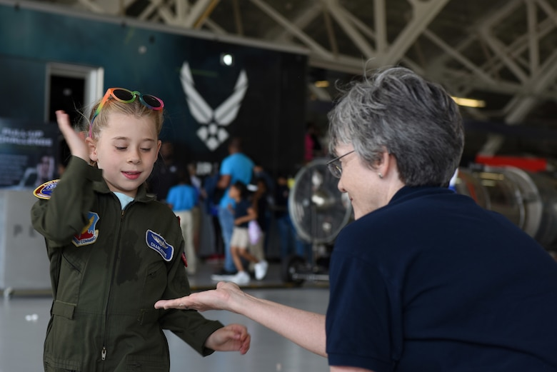 Secretary of the Air Force Heather Wilson receives a high-five from a child