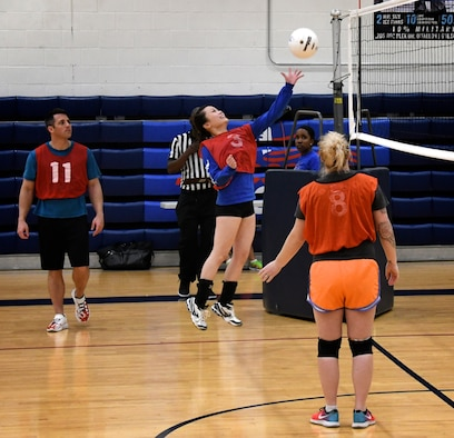 The commander of the 932nd Airlift Wing Logistics Flight, Capt. James Harbison, watches Senior Airman Katie Baskerville, 932nd Force Support Squadron, hit the volleyball back to the opposing team during intense league intramural competition May 16, 2019, at Scott Air Force Base, Ill.
