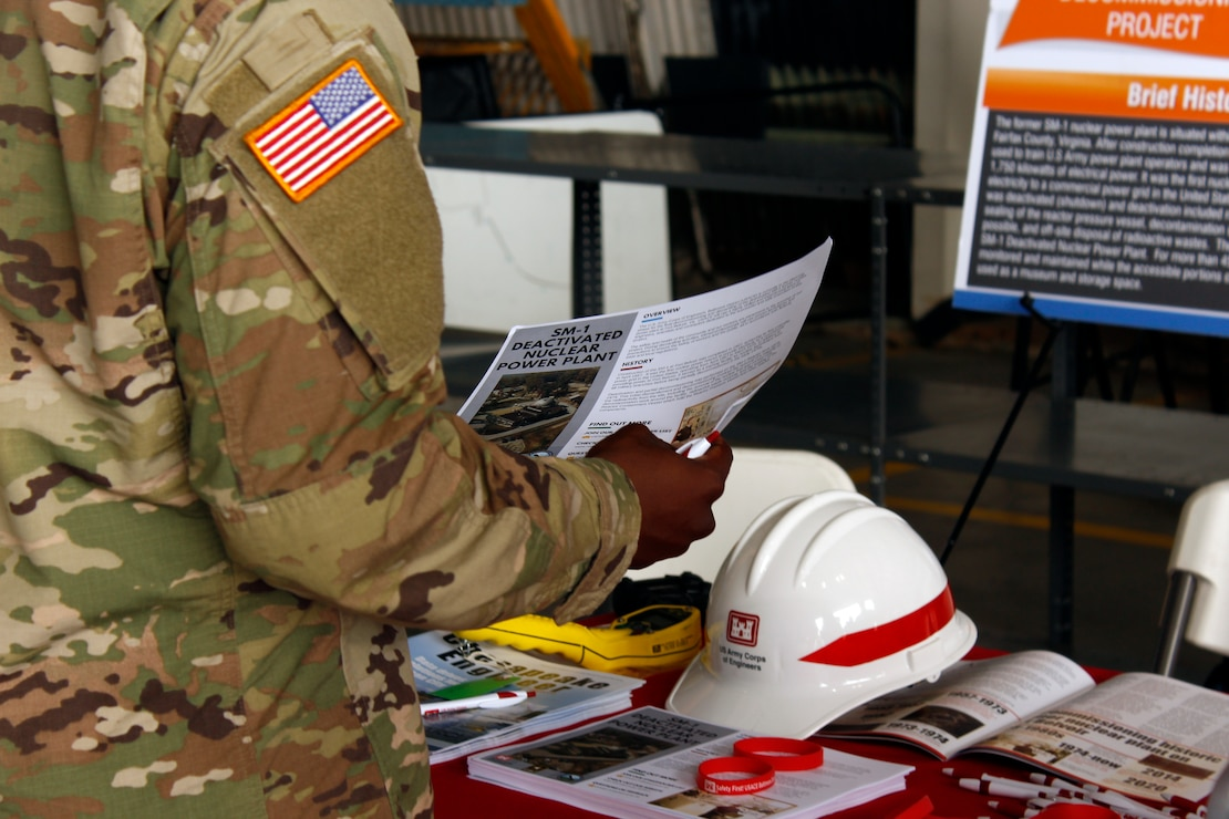 A Soldier reads an informational handout about the ongoing planning for the final decommissioning and dismantling of the Deactivated SM-1 Nuclear Power Plant at Fort Belvoir during the Army Aviation Brigade's Safety Stand Down at Davison Army Airfield Thursday May 23, 2019. The SM-1 project team participated in the event as part of ongoing outreach efforts to inform members of the Fort Belvoir community about the SM-1 project, help create an understanding of the nature of the project and address potential concerns. More information about the SM-1 project is available online at www.nab.usace.army.mil/SM-1