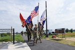 Members of the Defense Intelligence Agency's color guard cross the finish line at the 2019 Team JBAB Memorial March, on Joint Base Anacostia-Bolling, Washington, D.C., May 23.