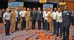 (left center) DLA Director Army Lt. Gen. Darrell Williams and DLA Energy Commander Air Force Lt. Gen. Albert Miller kicked off the conference opening networking session where attendees could meet and talk with DLA Energy's business unit directors. Photo by Connie Braesch