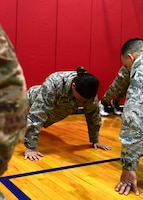 Senior Airman Karissa Lee, 911th Security Forces Squadron personnel specialist, does the push-up portion of the U.S. Army physical fitness test at the Pittsburgh International Airport Air Reserve Station, Pennsylvania, May 4, 2019. In order to qualify for the Combat Air Assault training, candidates must pass a U.S. Army physical fitness test 30 days before the school starts to ensure they have the strength and endurance needed to complete the course. (U.S. Air Force photo by Senior Airman Grace Thomson)