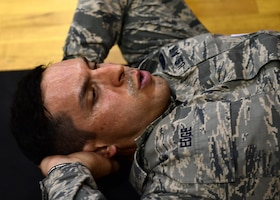Senior Airman Christopher Edge, 911th Logistics Readiness Squadron supply technician, does the sit-up portion of the U.S. Army physical fitness test at the Pittsburgh International Airport Air Reserve Station, Pennsylvania, May 4, 2019. In order to qualify for the Combat Air Assault training, candidates must pass a U.S. Army physical fitness test 30 days before the school starts to ensure they have the strength and endurance needed to complete the course. (U.S. Air Force photo by Senior Airman Grace Thomson)