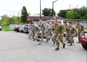 Airmen assigned to the 911th Airlift Wing begin a two-mile run as part of the U.S. Army physical fitness test at the Pittsburgh International Airport Air Reserve Station, Pennsylvania, May 4, 2019. In order to qualify for the Combat Air Assault training, candidates must pass a U.S. Army physical fitness test 30 days before the school starts to ensure they have the strength and endurance needed to complete the course. (U.S. Air Force photo by Senior Airman Grace Thomson)
