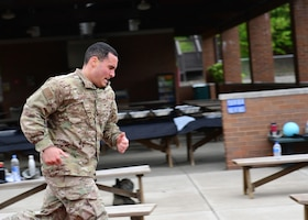 Staff Sgt. James Krobot, 911th Maintenance Squadron sheet metal technician, finishes the running portion of the U.S. Army physical fitness test at the Pittsburgh International Airport Air Reserve Station, Pennsylvania, May 4, 2019. The two-mile run was a course around the base with hills and straight-aways, and only the last portion of the run was on the track. (U.S. Air Force photo by Senior Airman Grace Thomson)