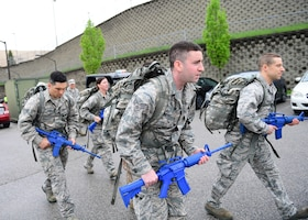Airmen assigned to the 911th Airlift Wing, begin a six-mile ruck march at the Pittsburgh International Airport Air Reserve Station, Pennsylvania, May 5, 2019. A ruck march is when Airmen carry a backpack full of weights and walk at a vigorous pace over a predetermined course to build up their physical and mental endurance. (U.S. Air Force photo by Senior Airman Grace Thomson)