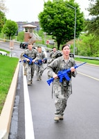 Senior Airman Karissa Lee, 911th Security Forces Squadron personnel specialist, leads the pack of 911th Airlift Wing Airmen on a ruck march at the Pittsburgh International Airport Air Reserve Station, Pennsylvania, May 5, 2019. A ruck march is when Airmen carry a backpack full of weights and walk at a vigorous pace over a predetermined course to build up their physical and mental endurance. (U.S. Air Force photo by Senior Airman Grace Thomson)