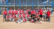 Members of the MCLB Barstow Marines, NTC Ft. Irwin Soldiers, and MCLB Fire Department teams, take time to pose for a photo together after the Armed Forces Softball Tournament held at the Robert A. Sessions Sportspark in Barstow, May 18.