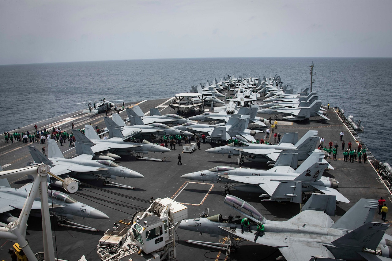 Flight deck covered with planes.