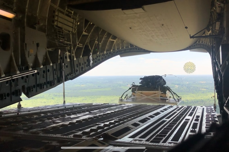 A pallet of cargo is air-dropped out the back out of a Charleston-based C-17 Globemaster III during the Palmetto Challenge Exercise May 23 near Pope Field, North Carolina.