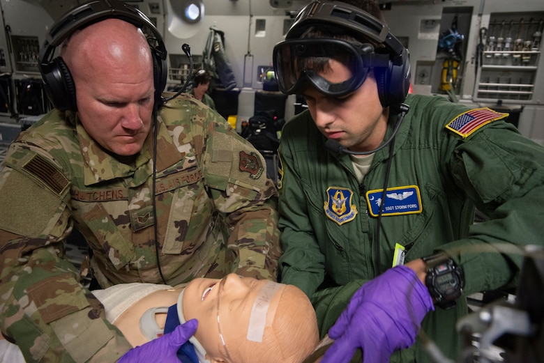 Staff Sergeants Aaron Hutchens and Storm Ford, 315th Aeromedical Evacuation Squadron, treat a simulated patient aboard a Charleston-based C-17 Globemaster III during the Palmetto Challenge Exercise May 22 near Pope Field, North Carolina.