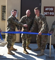 Perseverance paid off for OSI Detachment 613, Kunsan Air Base, Republic of Korea. After 18 months of planning, renovating and working in other workspaces around the base, the det returned to its fully renovated facility following a ribbon cutting ceremony May 23, 2019. Conducting ribbon cutting are, left to right, Col. Dave Patterson, AFOSI 6th Field Investigations Region vice commander, Col. John Bosone, 8th Fighter Wing commander, and Special Agent Dustin Paulus, AFOSI Det. 613 commander. (U.S. Air Force photo by Staff Sgt. Mackenzie Mendez)