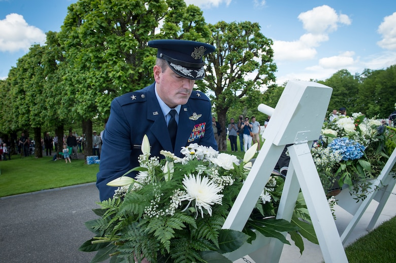 U.S. Air Force Brig. Gen. Mark R. August, 86th Airlift Wing commander, lays a wreath on a stand during a Memorial Day ceremony at the Saint-Mihiel American Cemetery, Thiaucourt-Regniéville, France, May 26, 2019. In addition to the more than 4,000 Americans who died and are buried there, the cemetery holds the names of 284 service members who are missing in action. (U.S. Air Force photo by Staff Sgt. Jonathan Bass)