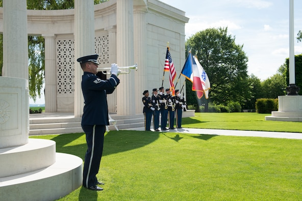 U.S. Air Force Staff Sgt. Nicholas Del Villano, U.S. Air Forces in Europe Jazz Band trumpeter, play taps on a bugle during a Memorial Day ceremony at the Saint-Mihiel American Cemetery, Thiaucourt-Regniéville, France, May 26, 2019. The ceremony at Saint-Mihiel American Cemetery recognized both the Americans and the French service members who perished in combat. (U.S. Air Force photo by Staff Sgt. Jonathan Bass)