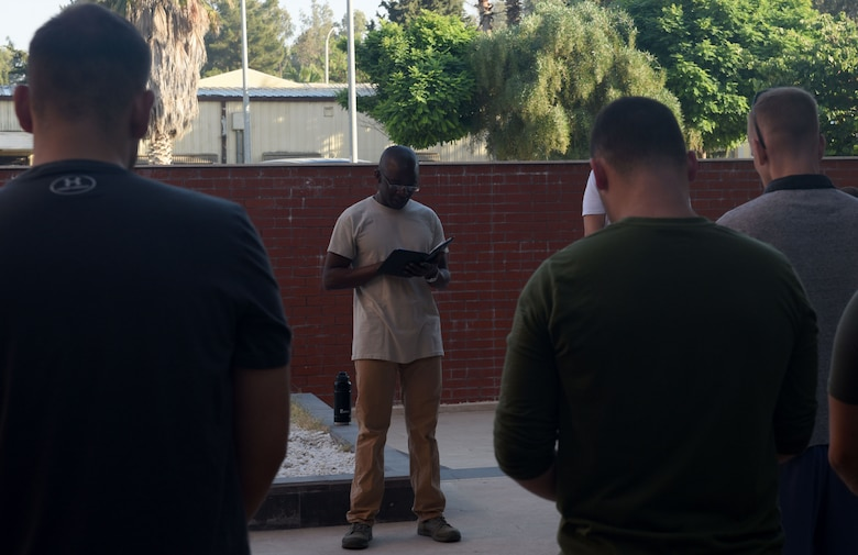 Chaplain Appiah giving the invocation before starting the ruck march.