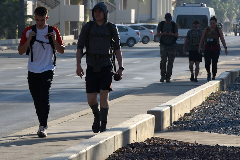Incirlik Airmen walking during the beginning of the Memorial Day Ruck March