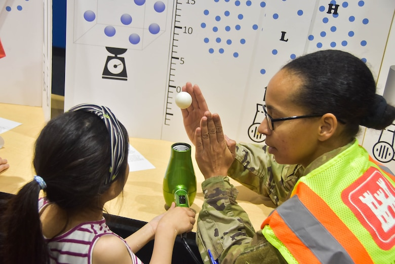 Capt. Heathra King, a U.S. Army Corps of Engineers, Far East District operations officer, interacts with a student during a Science, Technology, Engineering, and Math (STEM) event held at Humphreys Central Elementary School, Camp Humphreys, South Korea, May 23.