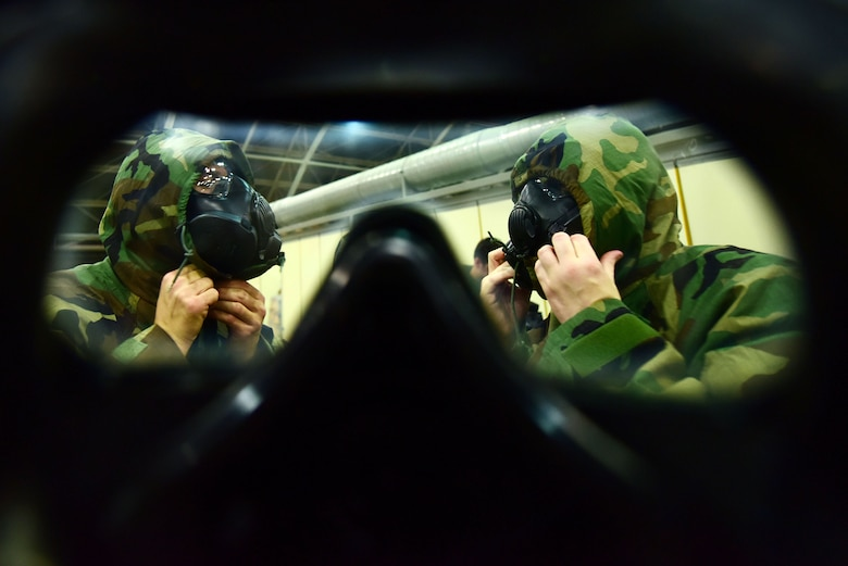 Airmen don M50 gas masks during Ability to Survive and Operate training May 24, 2019, at Incirlik Air Base, Turkey. The training was designed to reinforce Airmen's ability to utilize their Mission Oriented Protective Posture gear in a potential chemical environment. (U.S. Air Force photo by Tech. Sgt. Jim Araos)